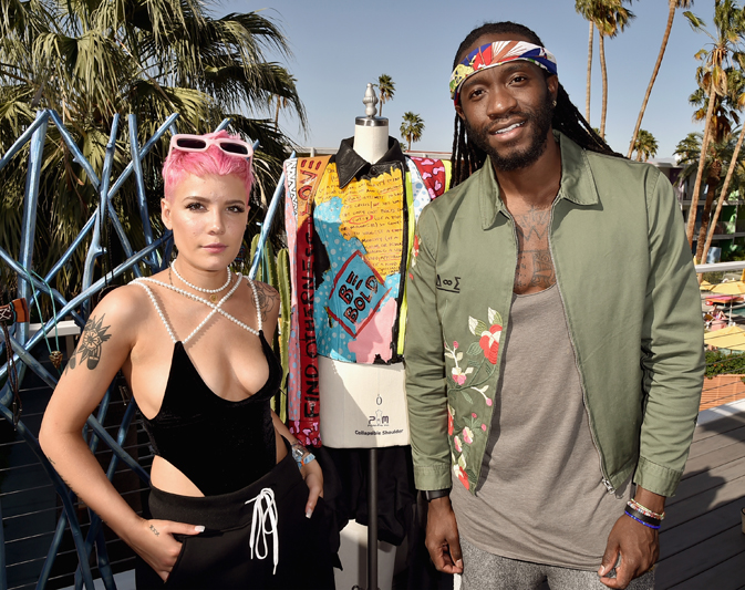PALM SPRINGS, CA - APRIL 13:  Singer Halsey (L) and artist Ron Bass celebrate Three Olives® Vodka Find Otherness, Thursday, April 13, 2017 at The Saguaro hotel, Palm Springs.  (Photo by David Crotty/WireImage)