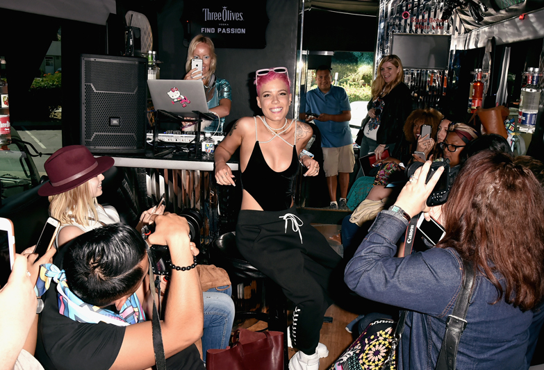 PALM SPRINGS, CA - APRIL 13:  Singer Halsey in the tour bus with fans at Three Olives® Vodka Find Otherness, Thursday, April 13, 2017 at The Saguaro hotel, Palm Springs.  (Photo by David Crotty/WireImage)